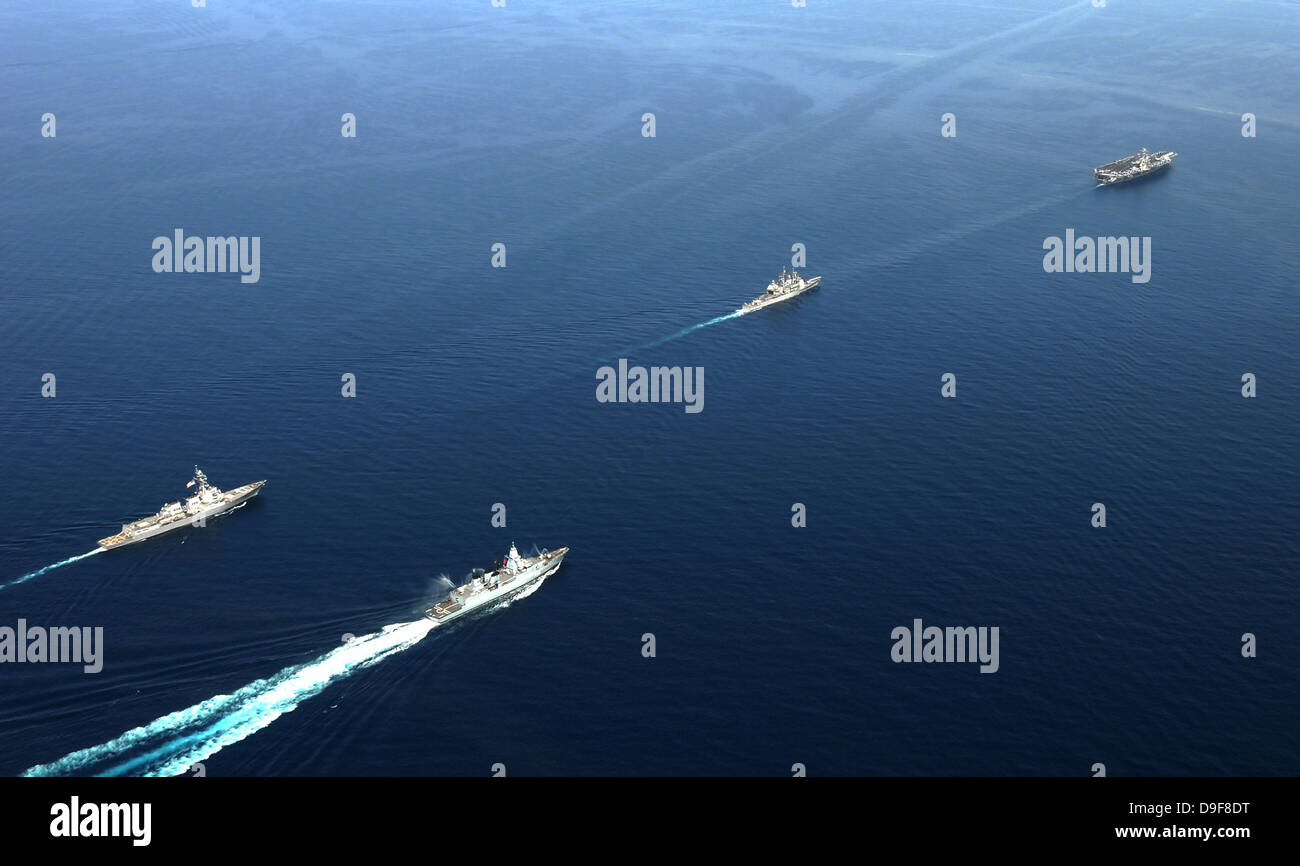 German Navy frigate FGS Hessen and the USS Harry S. Truman carrier strike group. - Stock Image