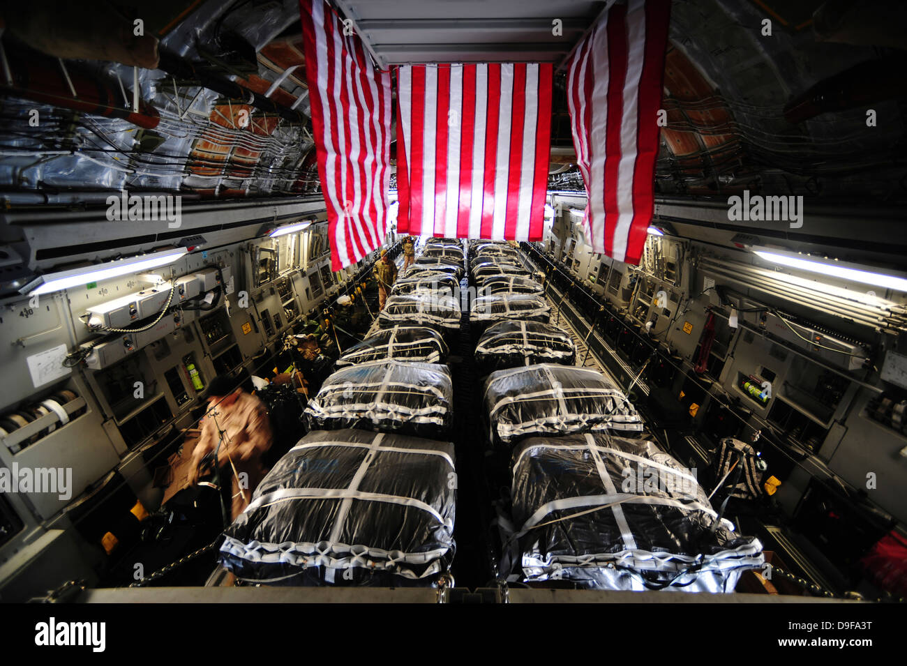 Pallets of cargo inside of a C-17 Globemaster III before conducting air delivery operations over Afghanistan. - Stock Image