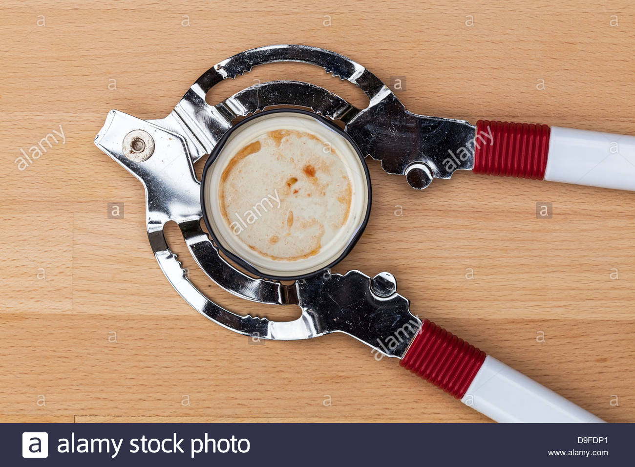 Jar or lid opener - kitchen gadget for opening food jars - Stock Image