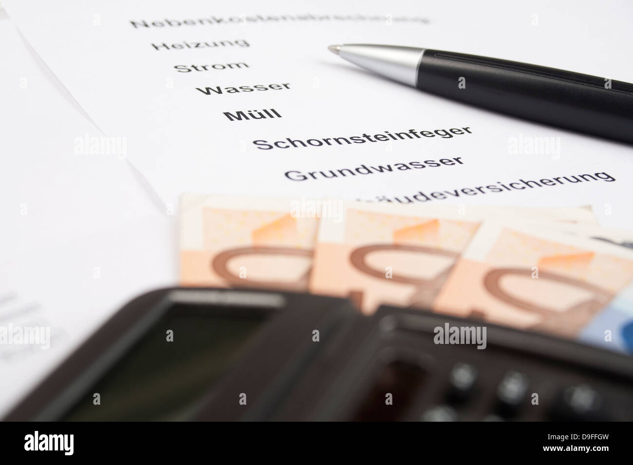 Expenses settlement with ballpoint pen and pocket calculator load settlement with pen and calculator - Stock Image