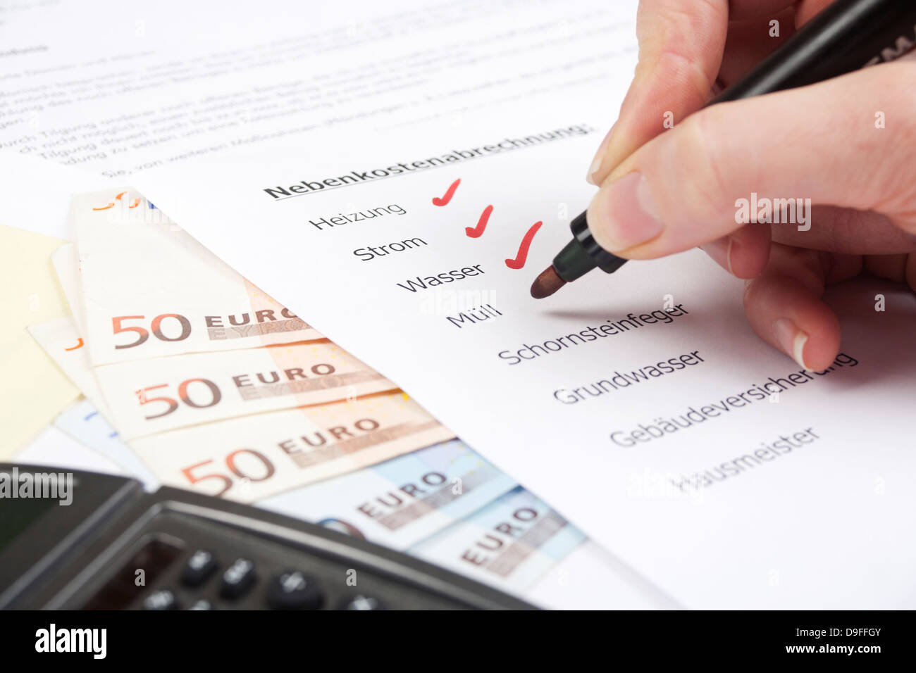 Expenses settlement with bank notes and pocket calculator load settlement with of Bill and calculator Stock Photo