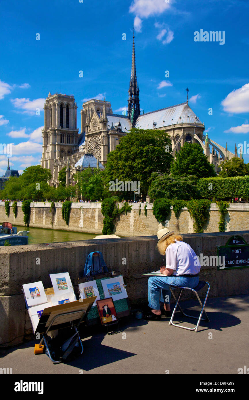 Artist by the River Seine overlooking Notre Dame, Paris, France Stock Photo