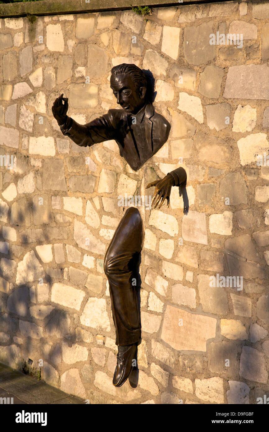 Sculpture of Le Passe Muraille (The Passer Through Walls)  by Jean Marais, Montmartre, Paris, France - Stock Image