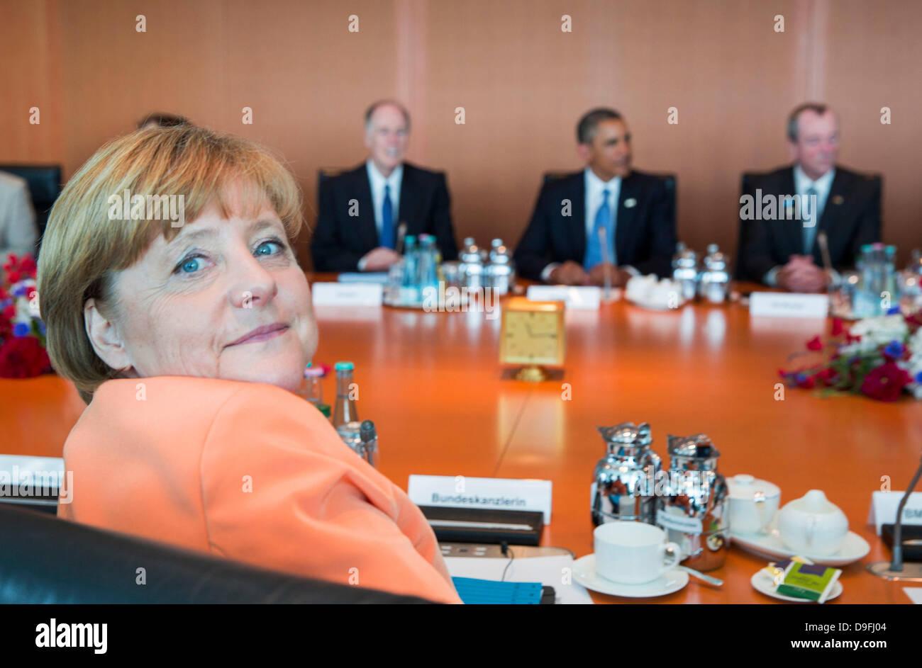 Berlin, Germany. 19th June, 2013. From left, German Chancellor Angela Merkel, National Security Advisor Thomas Donilon, - Stock Image