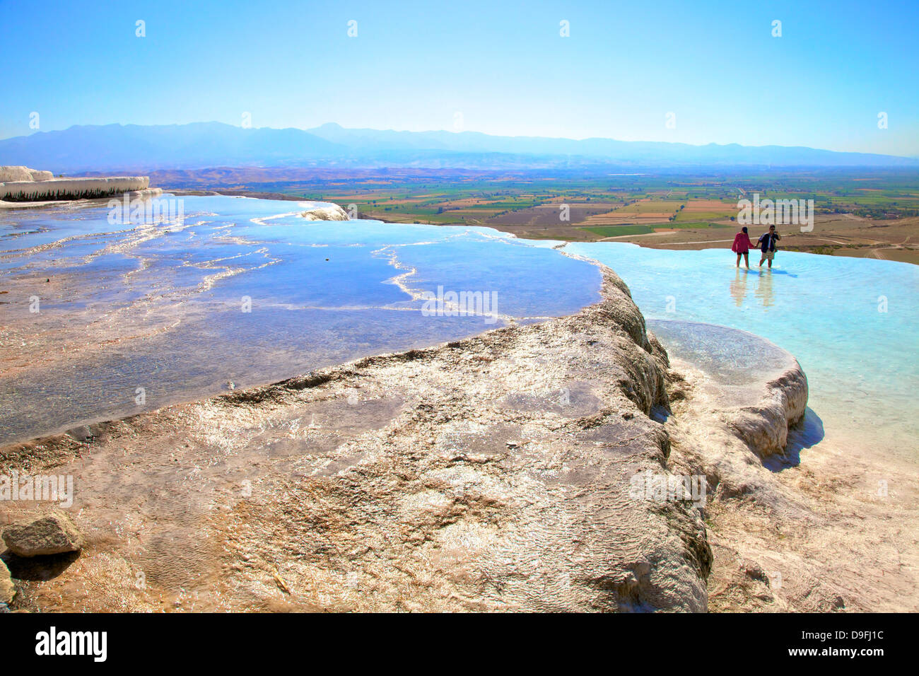 White travertine terraces at Pamukkale, UNESCO World Heritage Site, Anatolia, Turkey Minor, Eurasia - Stock Image
