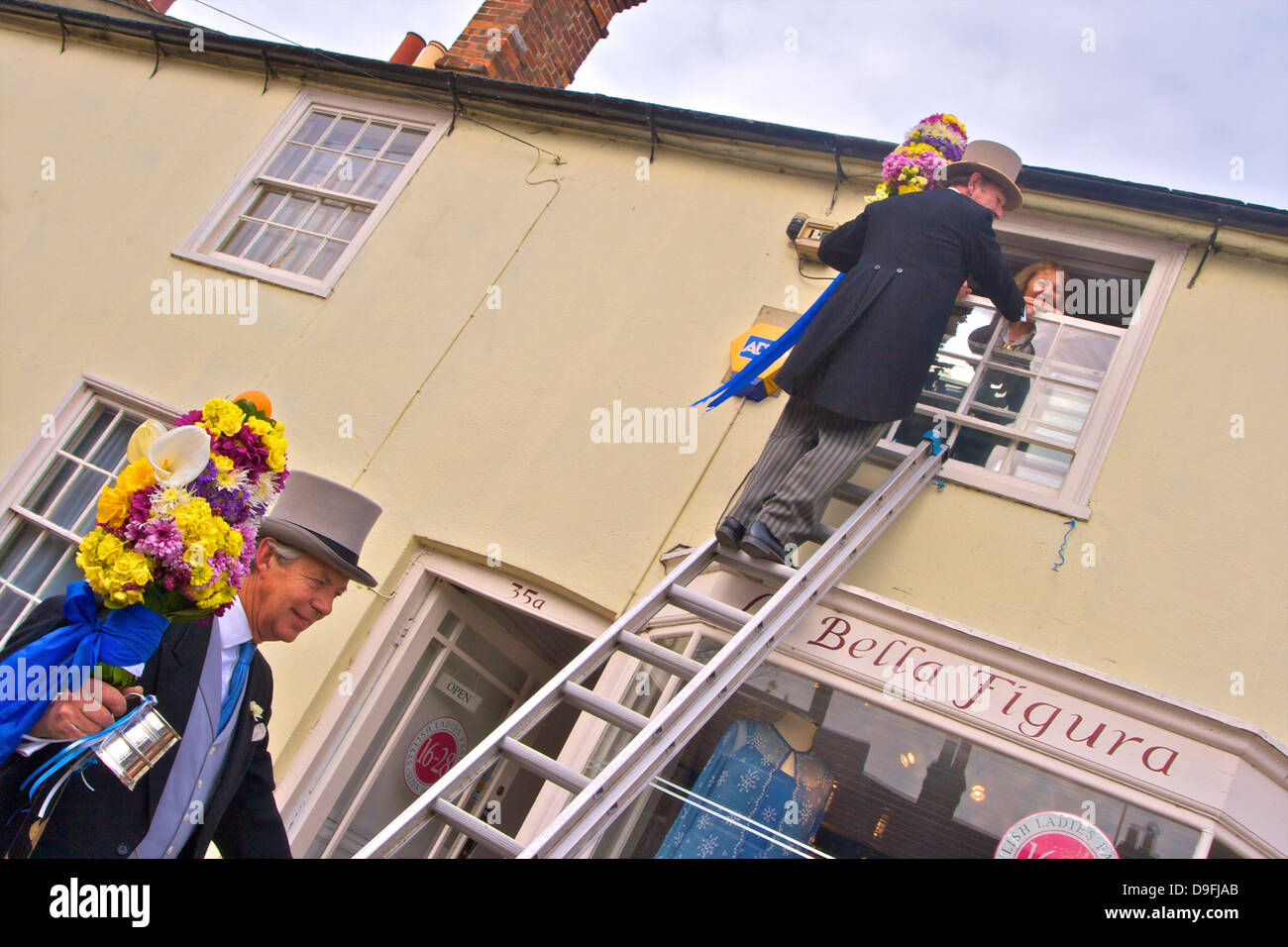 Tutti Man ascending ladder to receive a kiss, Tutti Day, annual Hocktide Festival, Hungerford, Berkshire, England, - Stock Image