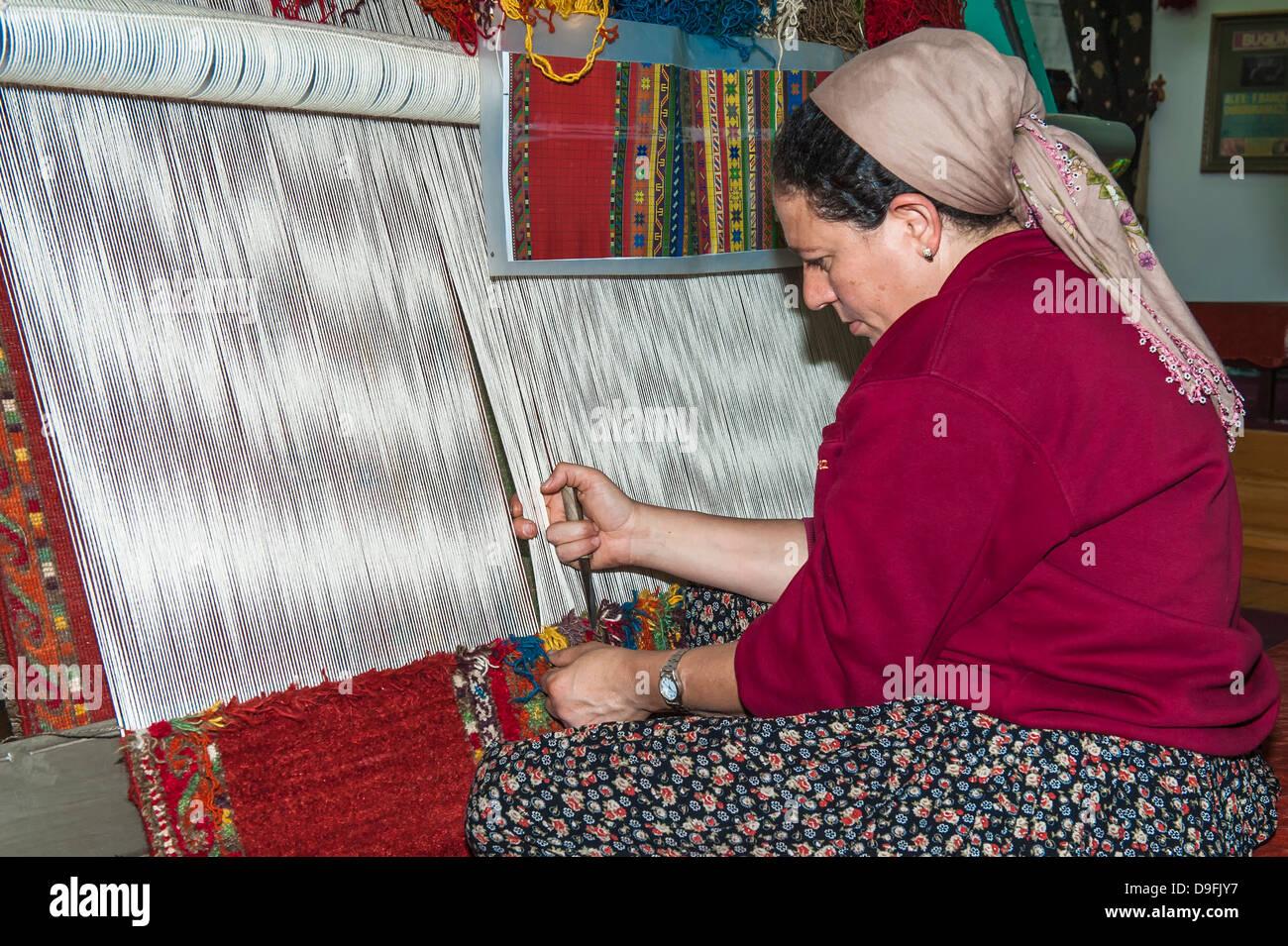 Woman weaving a carpet, Antalya, Anatolia, Turkey Minor, Eurasia - Stock Image