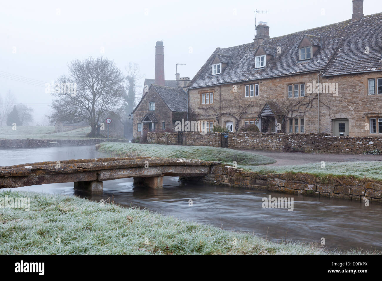 A misty and frosty winters morning, Lower Slaughter, Cotswolds, Gloucestershire, England, UK - Stock Image