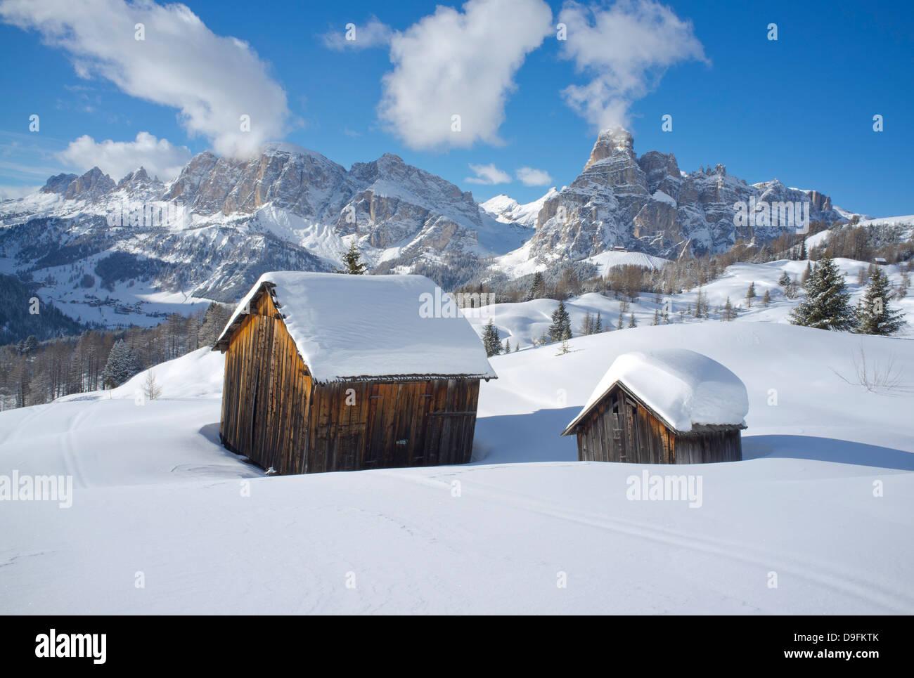 Mounts Lavarella, Conturines and Sasongher behind barns at the Alta Badia ski resort near Corvara, Dolomites, South - Stock Image