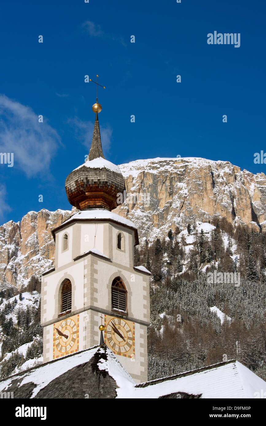 A church belltower in Colfosco in Badia in the Dolomites in the South Tyrol, Italy Stock Photo
