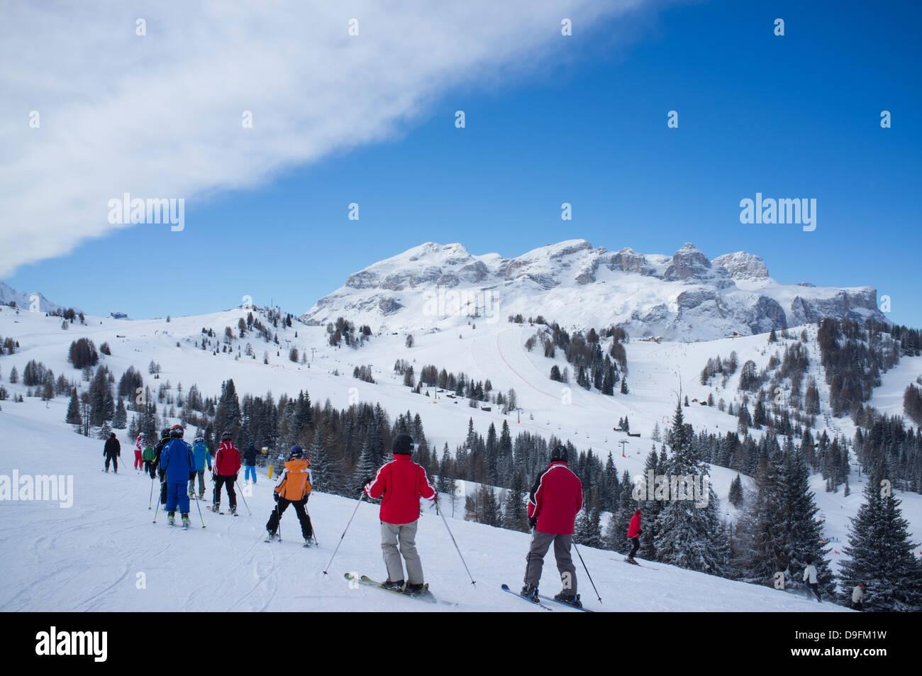 A group of skiers at the Alta Badia ski resort near Corvara, Dolomites, South Tyrol, Italy - Stock Image