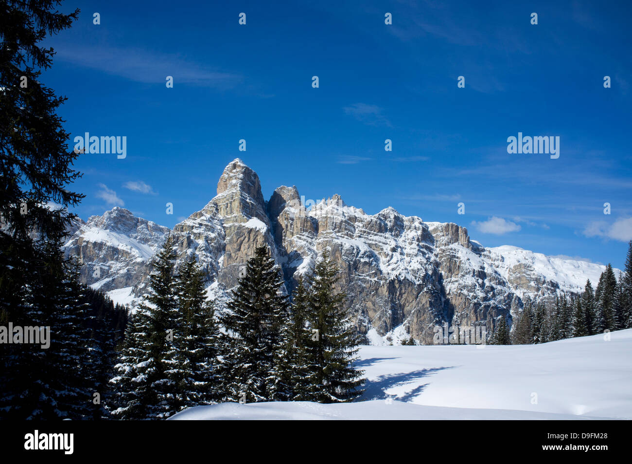 Sassongher Mountain seen from the snow covered Alta Badia ski resort near Corvara in the Dolomites, South Tyrol, Stock Photo