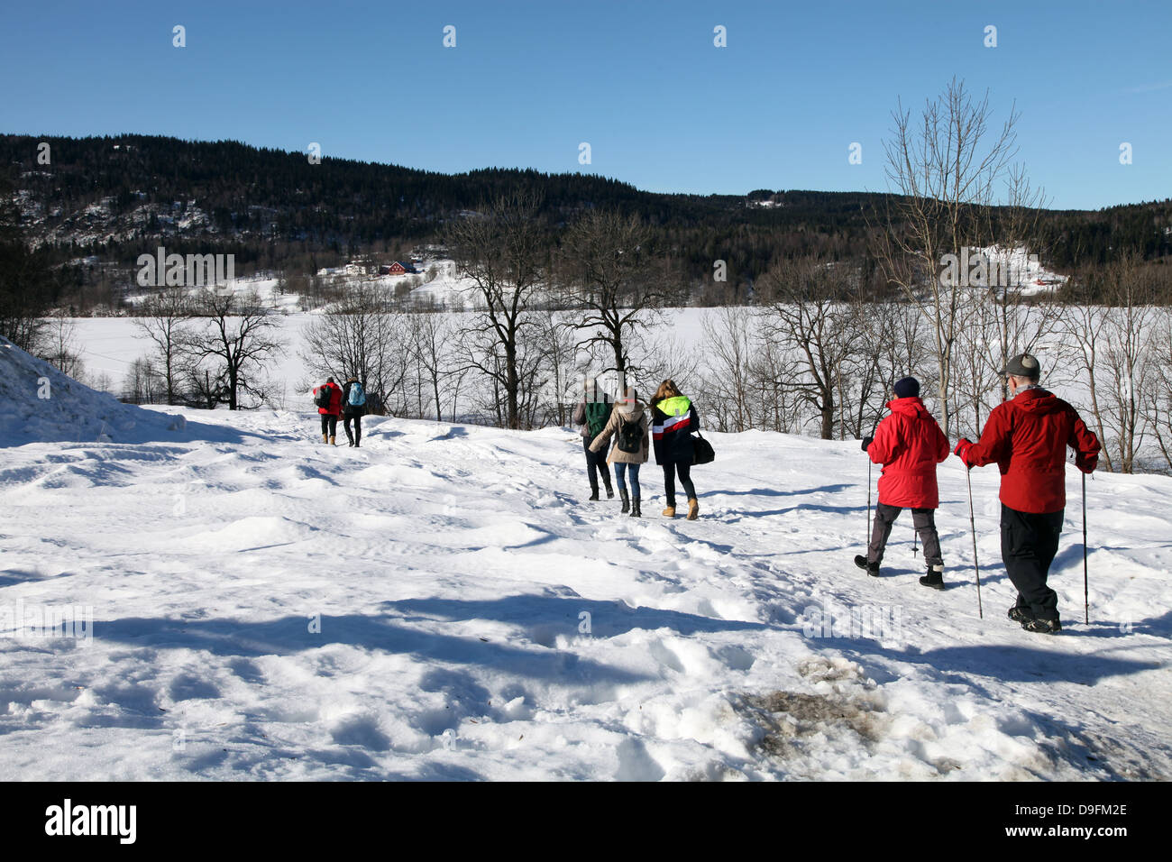Walkers in the snow at Sem Lake, Asker, South Norway, Scandinavia - Stock Image