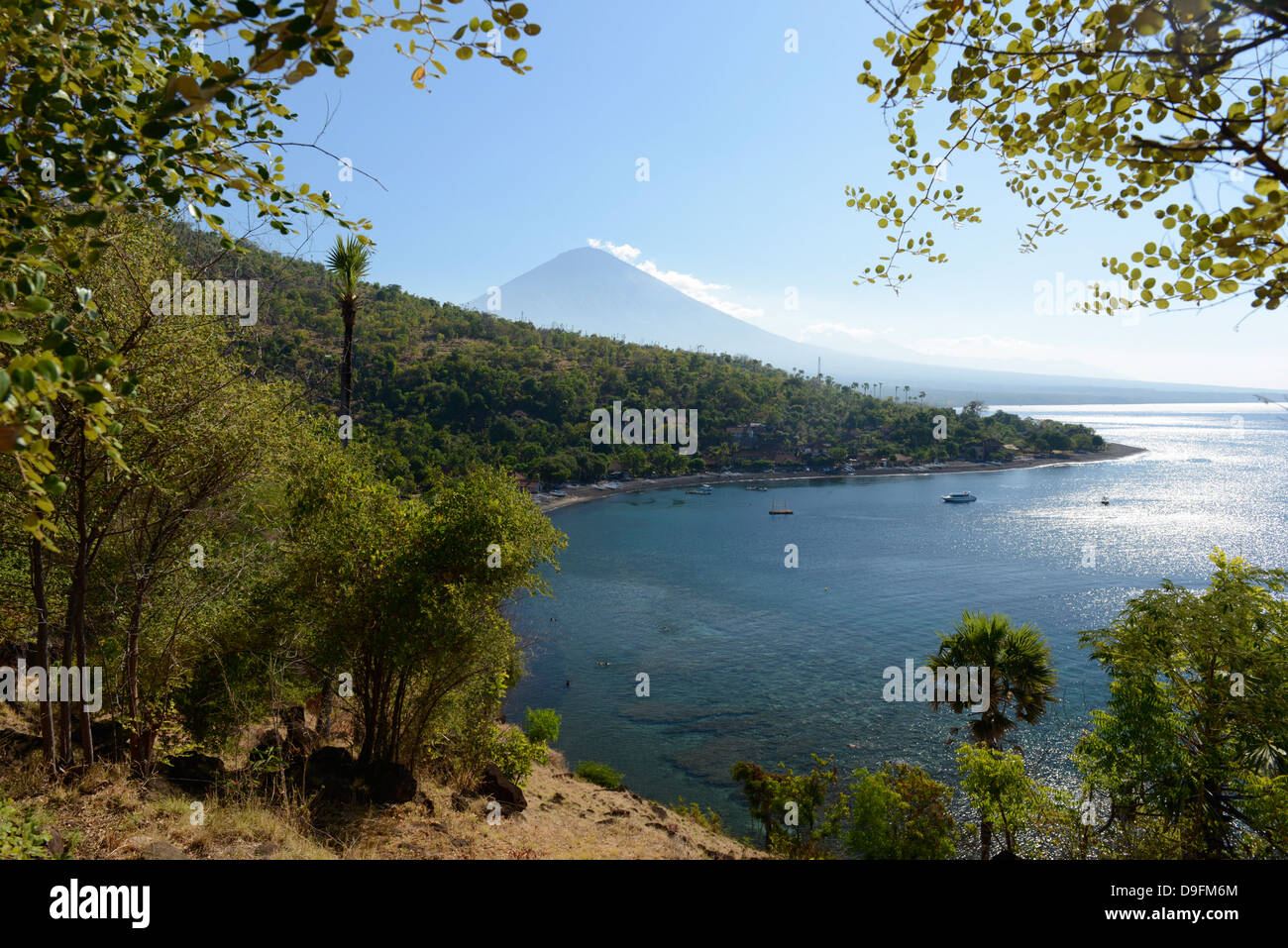 Amed, view of the coast and volcano of Gunung Agung, Bali, Indonesia, Southeast Asia - Stock Image