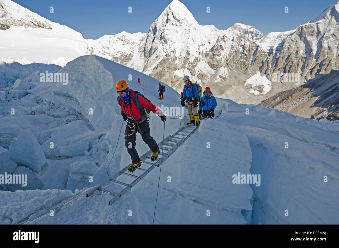 Crossing ladders in the Khumbu icefall on Mount Everest, Sagarmatha National Park, UNESCO World Heritage Site, Nepal, - Stock Image