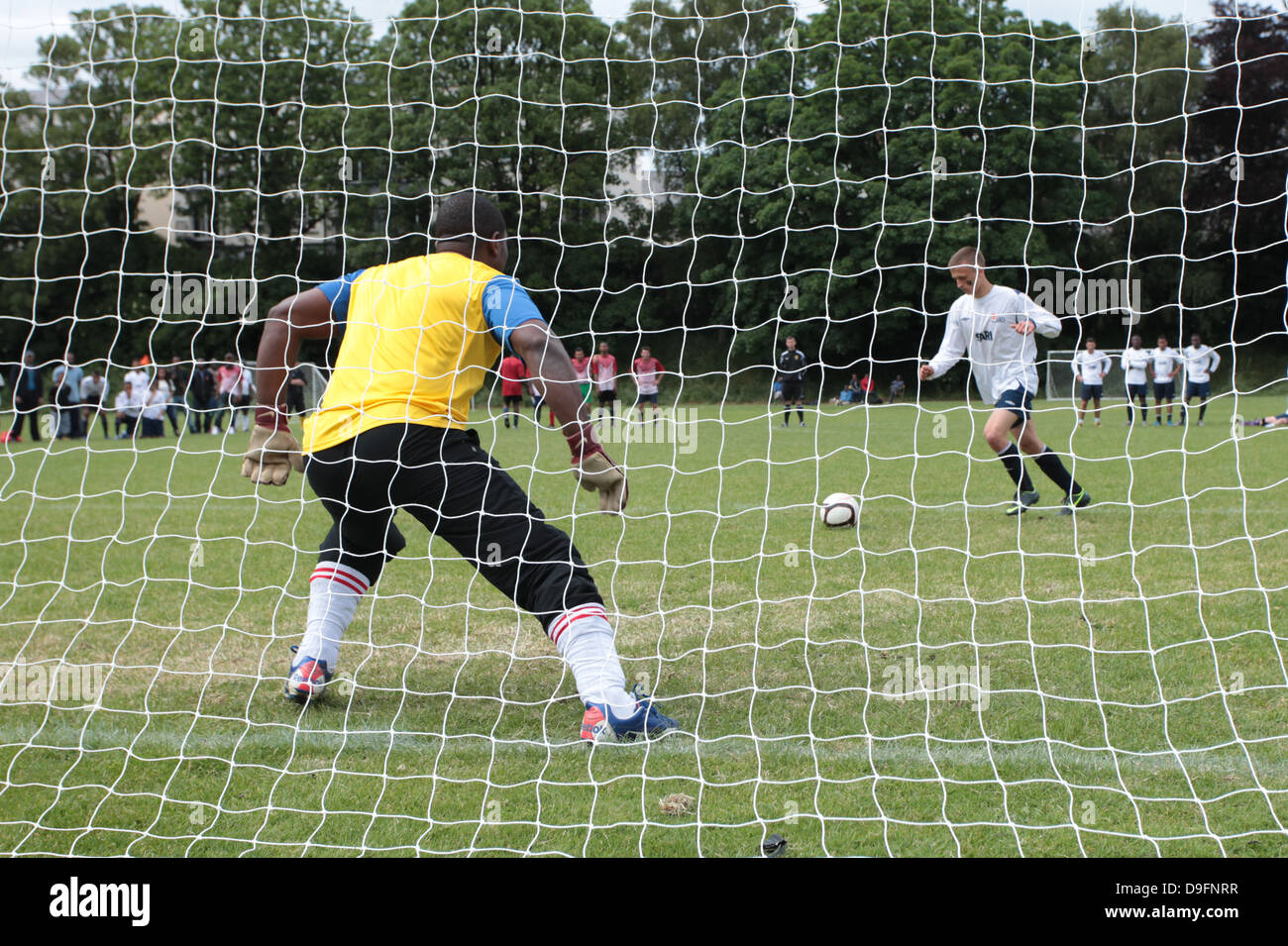 A footballer about to take a penalty kick. Playing football. Playing soccer. - Stock Image