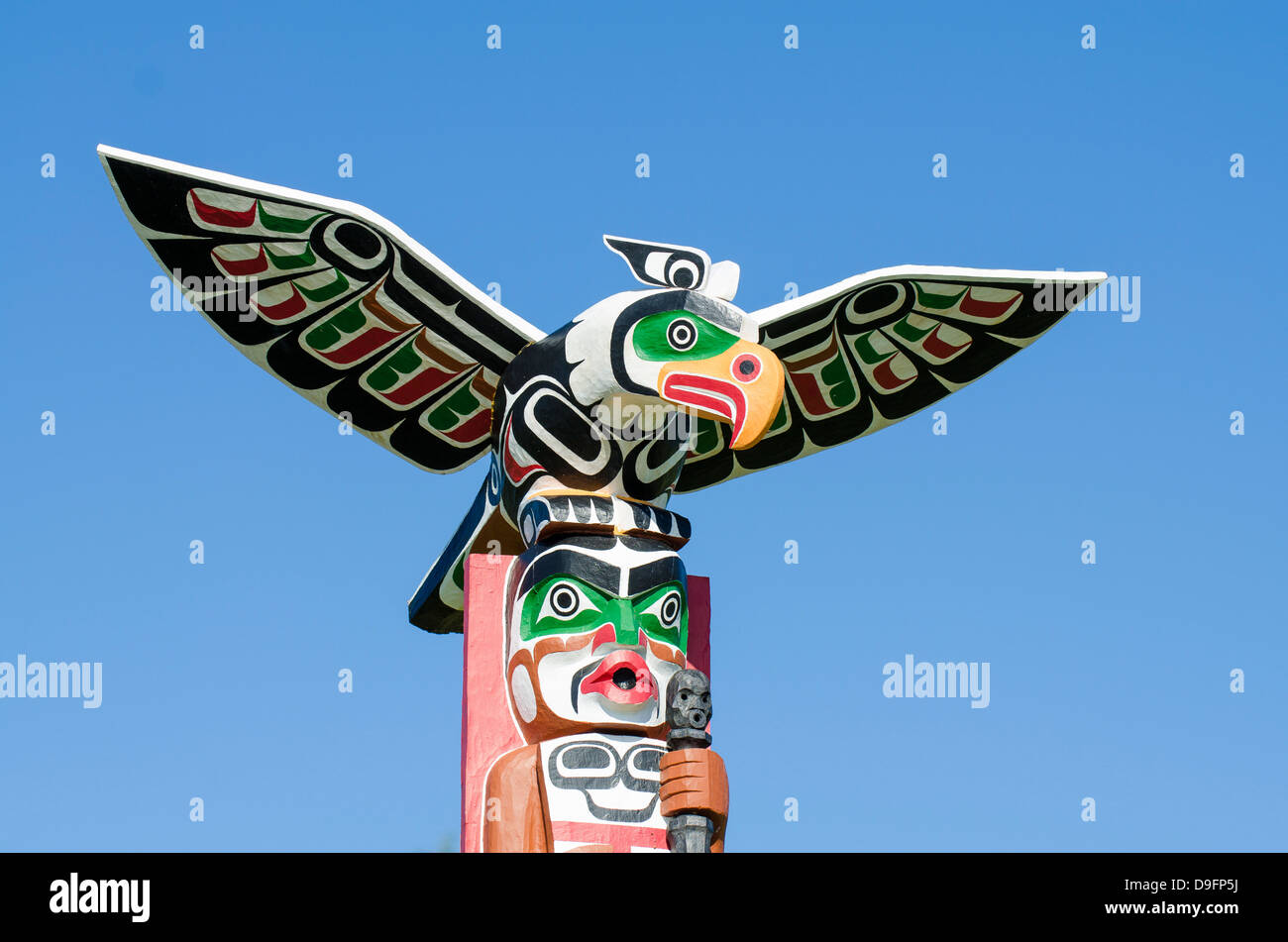Totem poles in cemetery in Alert Bay, British Columbia, Canada - Stock Image