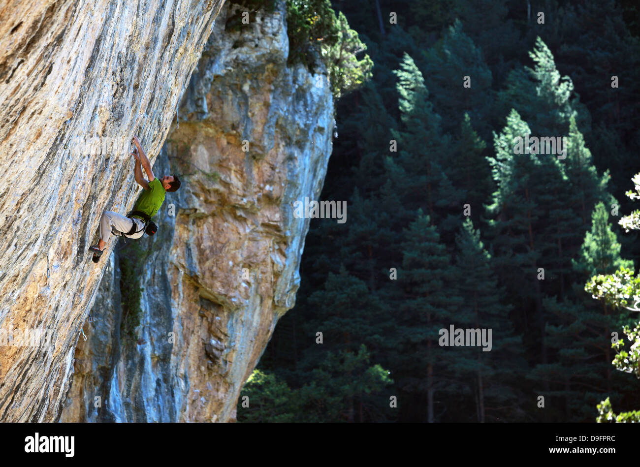 A climber scales cliffs at Bielsa, Spanish Pyrenees, Spain - Stock Image