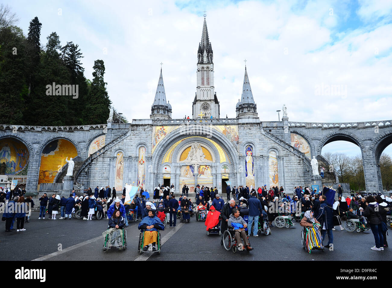 Gathering at Notre-Dame-du-Rosaire's basilica in the city of Lourdes, Hautes-Pyrenees, France Stock Photo