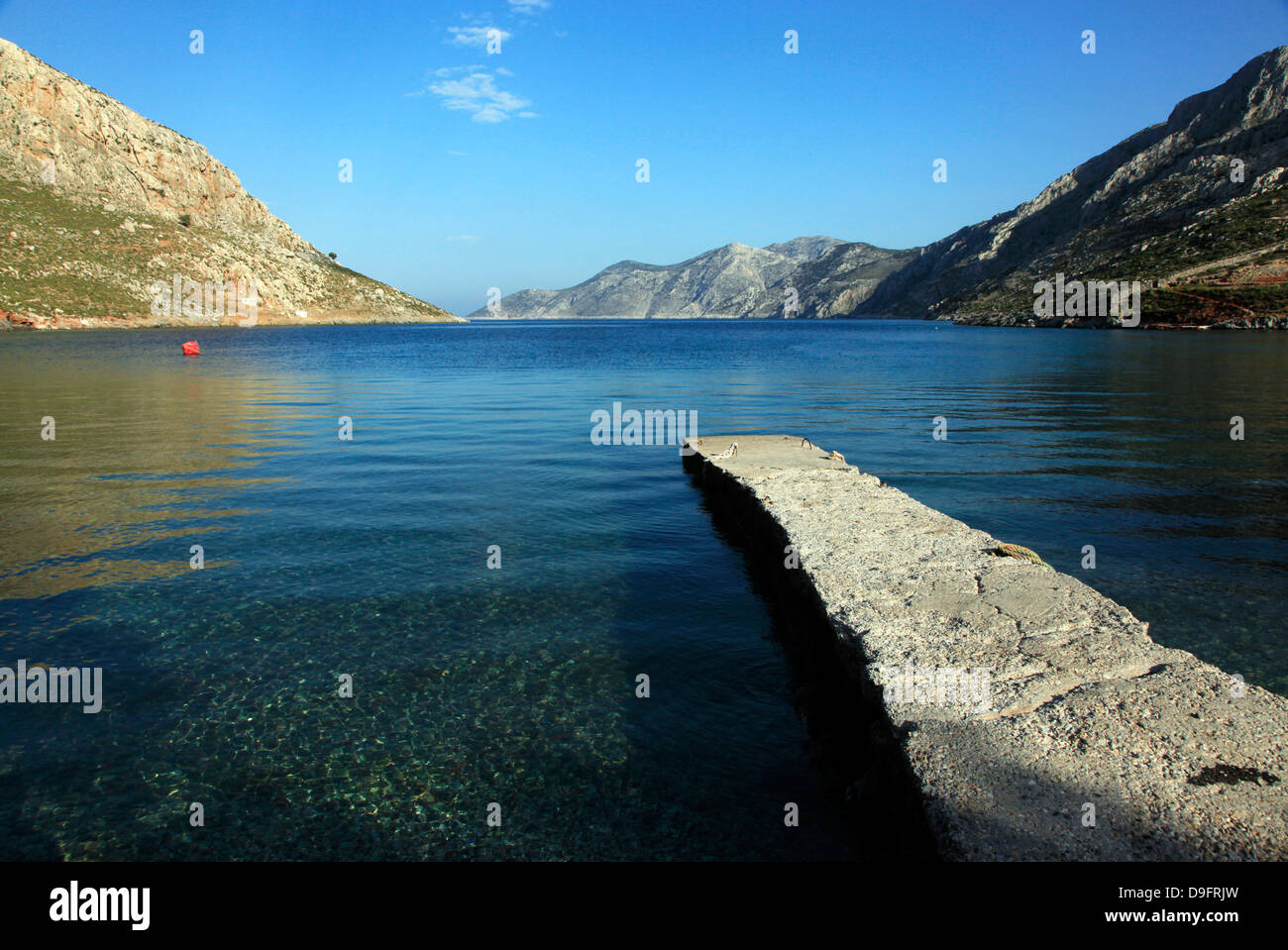 Jetty on the secluded and remote north coast of Kalymnos island, Dodecanese, Greek Islands, Greece - Stock Image