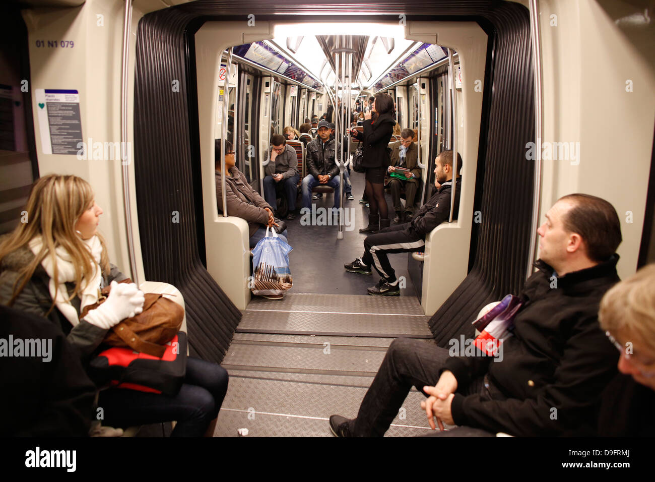 Passengers on the Paris Metro, Paris, France - Stock Image