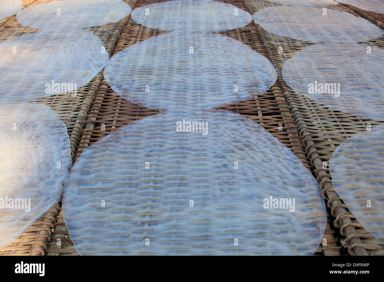 Rice paper crepes drying, Rice Noodle Factory, Mekong Delta, Can Tho Province, Vietnam, Indochina, Southeast Asia - Stock Image