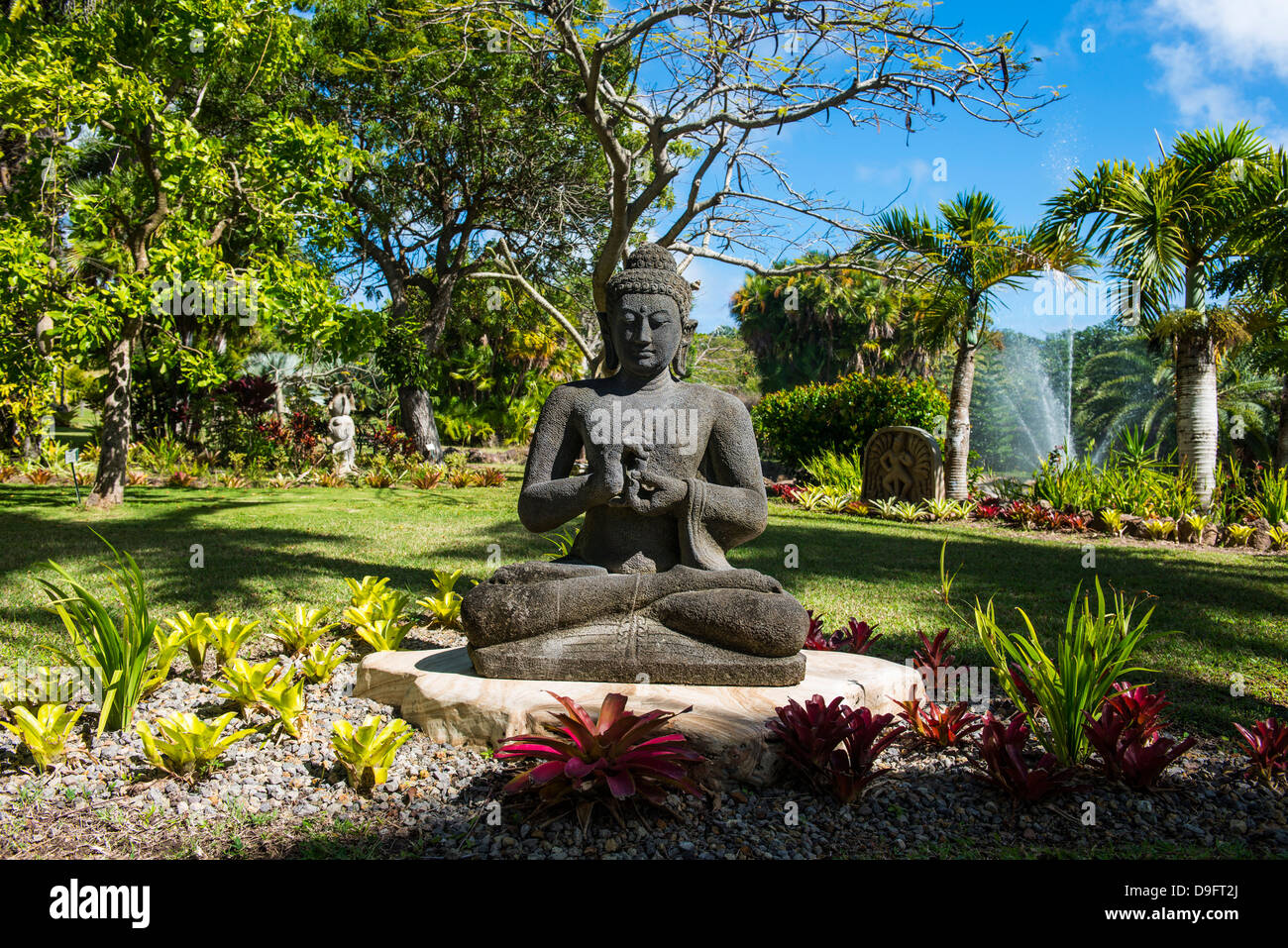 Buddhist statues in the Botanical gardens in Nevis island, St. Kitts and Nevis, Caribbean - Stock Image