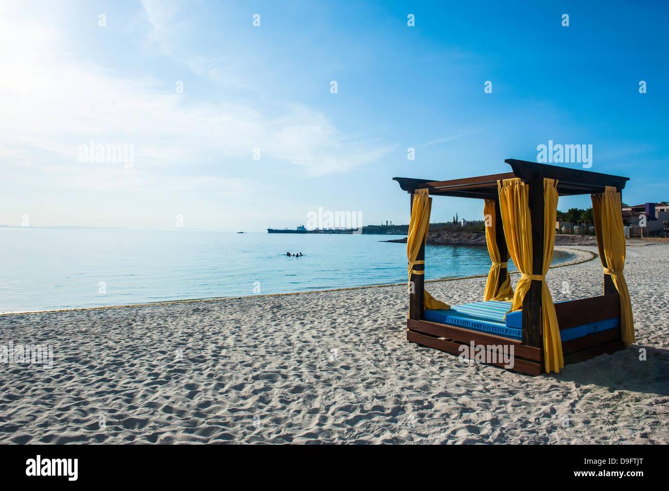 Huge double bed on the beach of Playa Palmira near La Paz, Baja California, Mexico - Stock Image