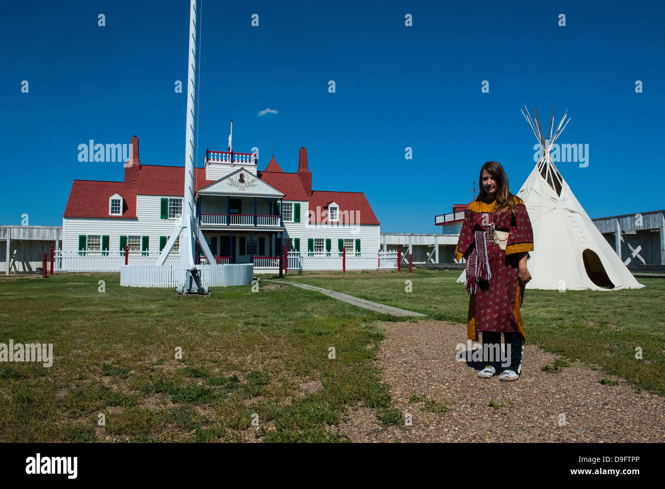Indian dressed girl in front of a wigwam in Fort Union, North Dakota, USA - Stock Image