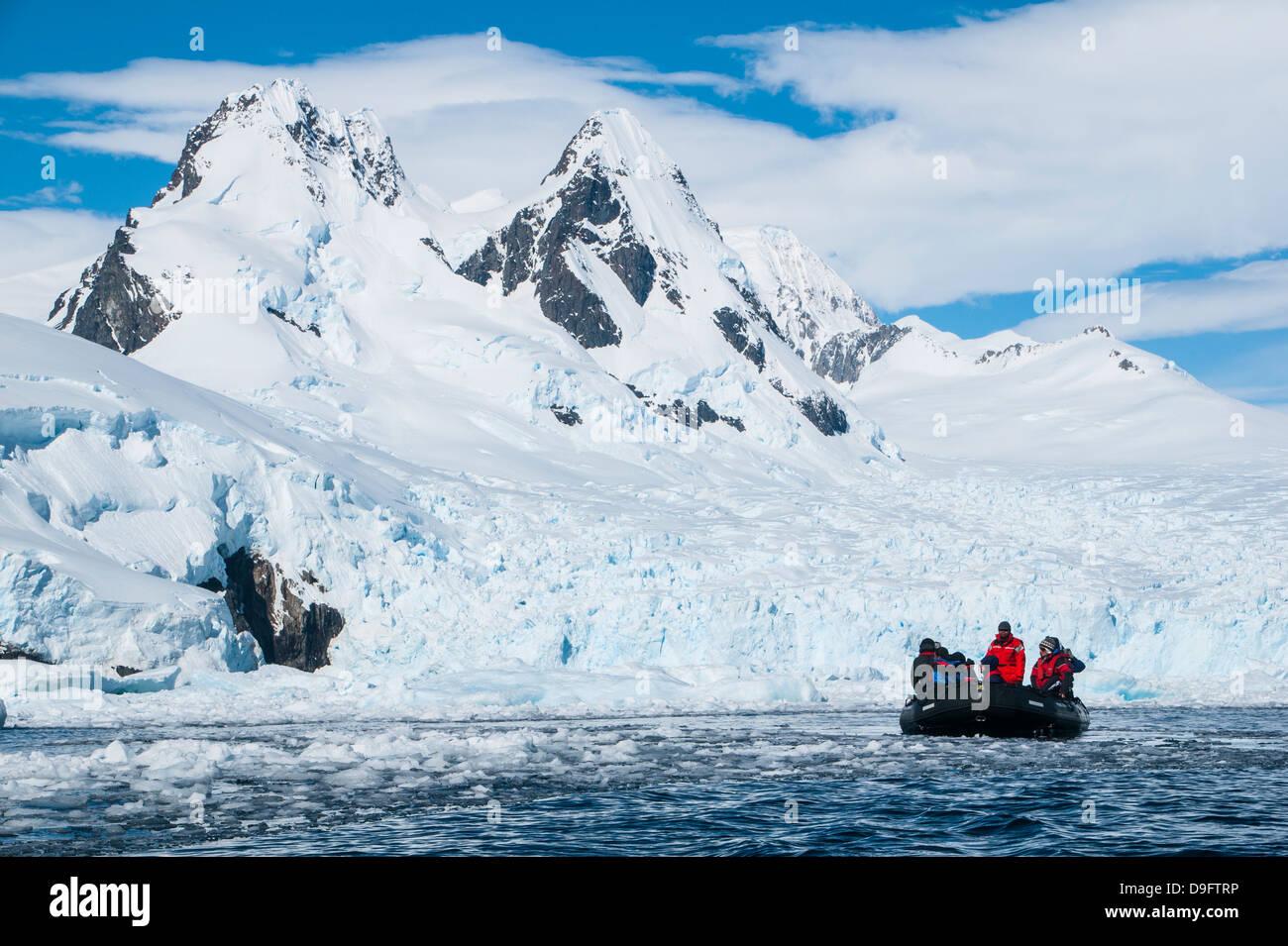 Tourists in a Zodiac in front of glaciers in Cierva Cove, Antarctica, Polar Regions - Stock Image