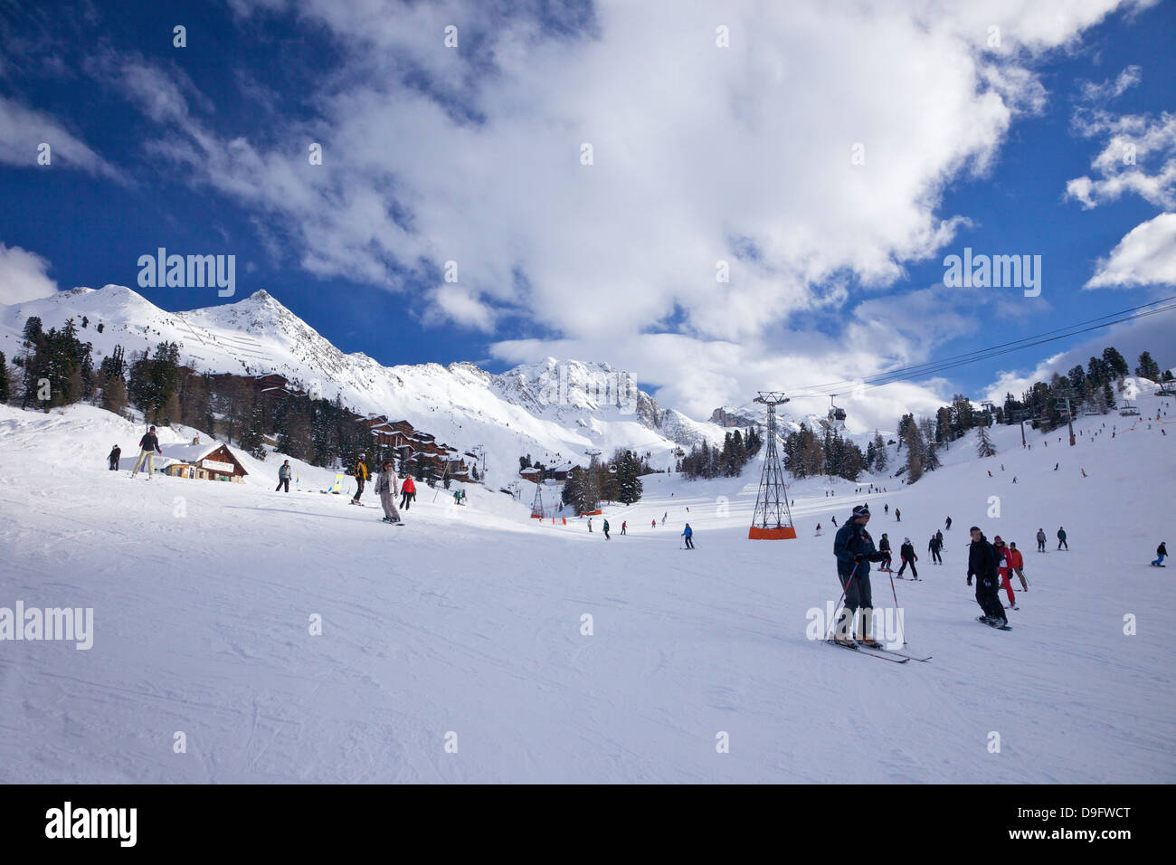 Skiers on piste at Belle Plagne, La Plagne, Savoie, French Alps, France - Stock Image