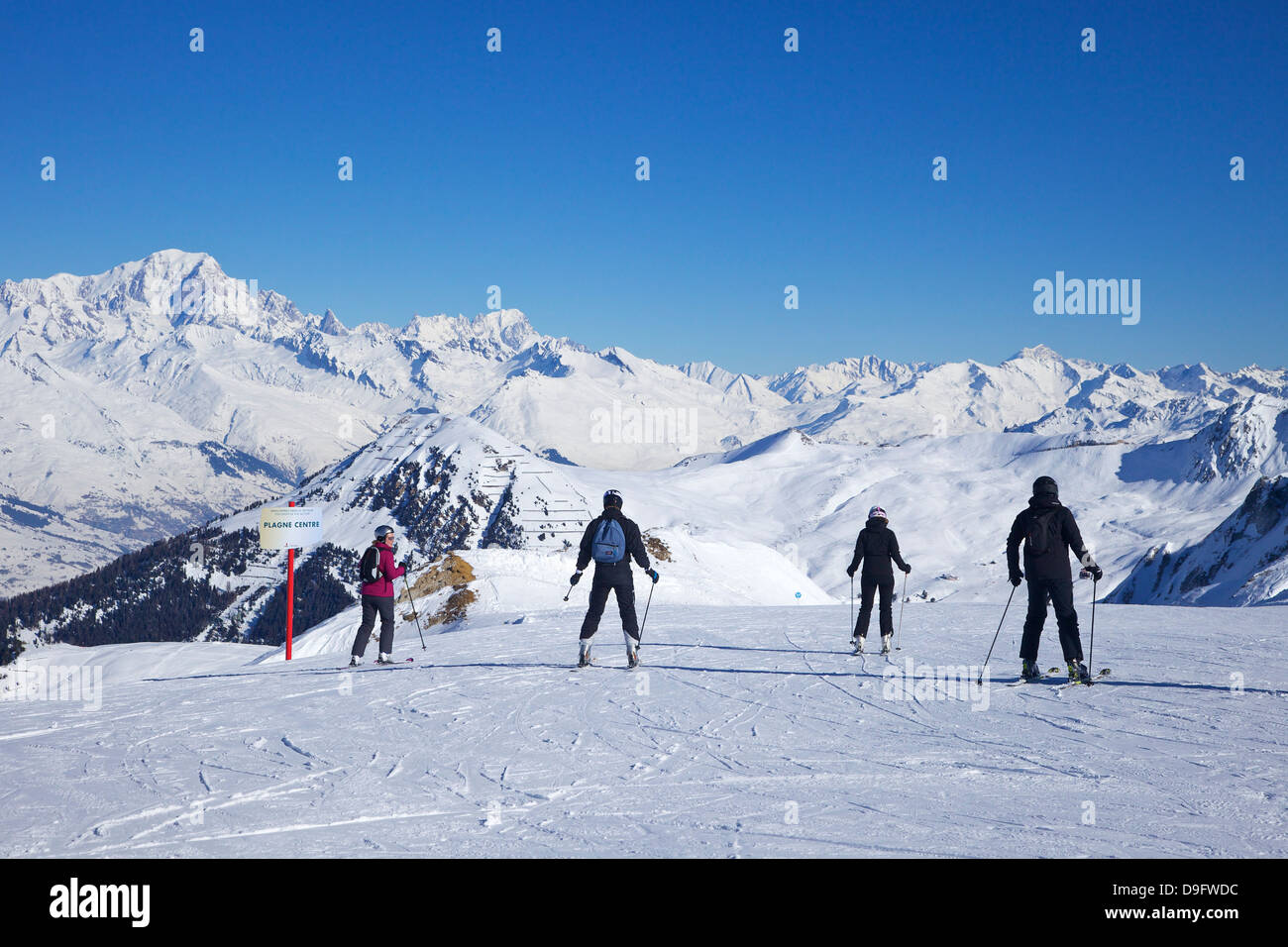 Skiers on the piste to Plagne Centre, La Plagne, French Alps, France - Stock Image