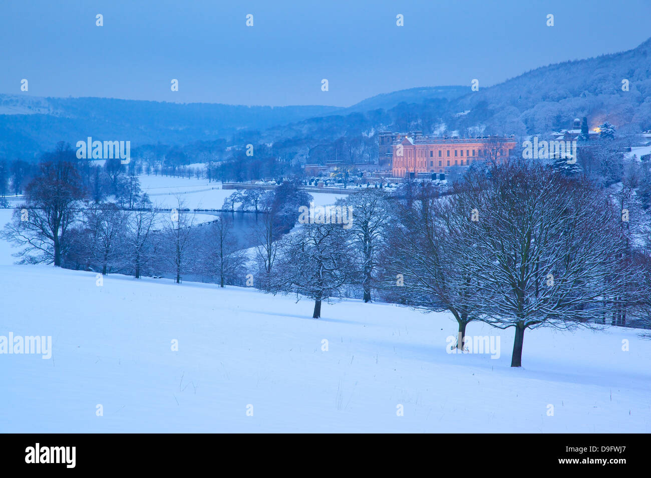 Chatsworth House and snow, Derbyshire Dales, Derbyshire, England, UK - Stock Image