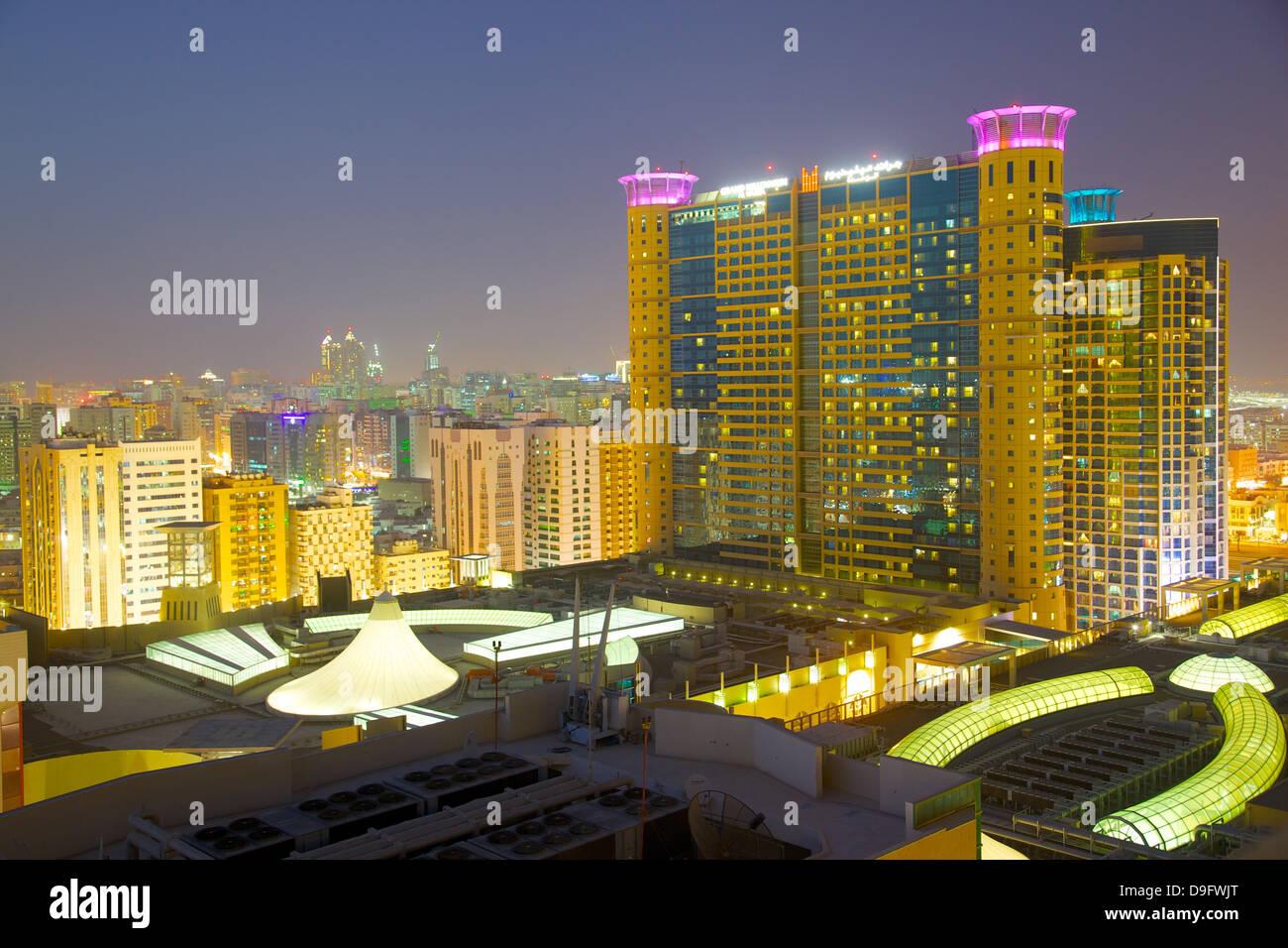 Grand Millennium Hotel and Al Wahda Mall at dusk, Abu Dhabi, United Arab Emirates, Middle East - Stock Image