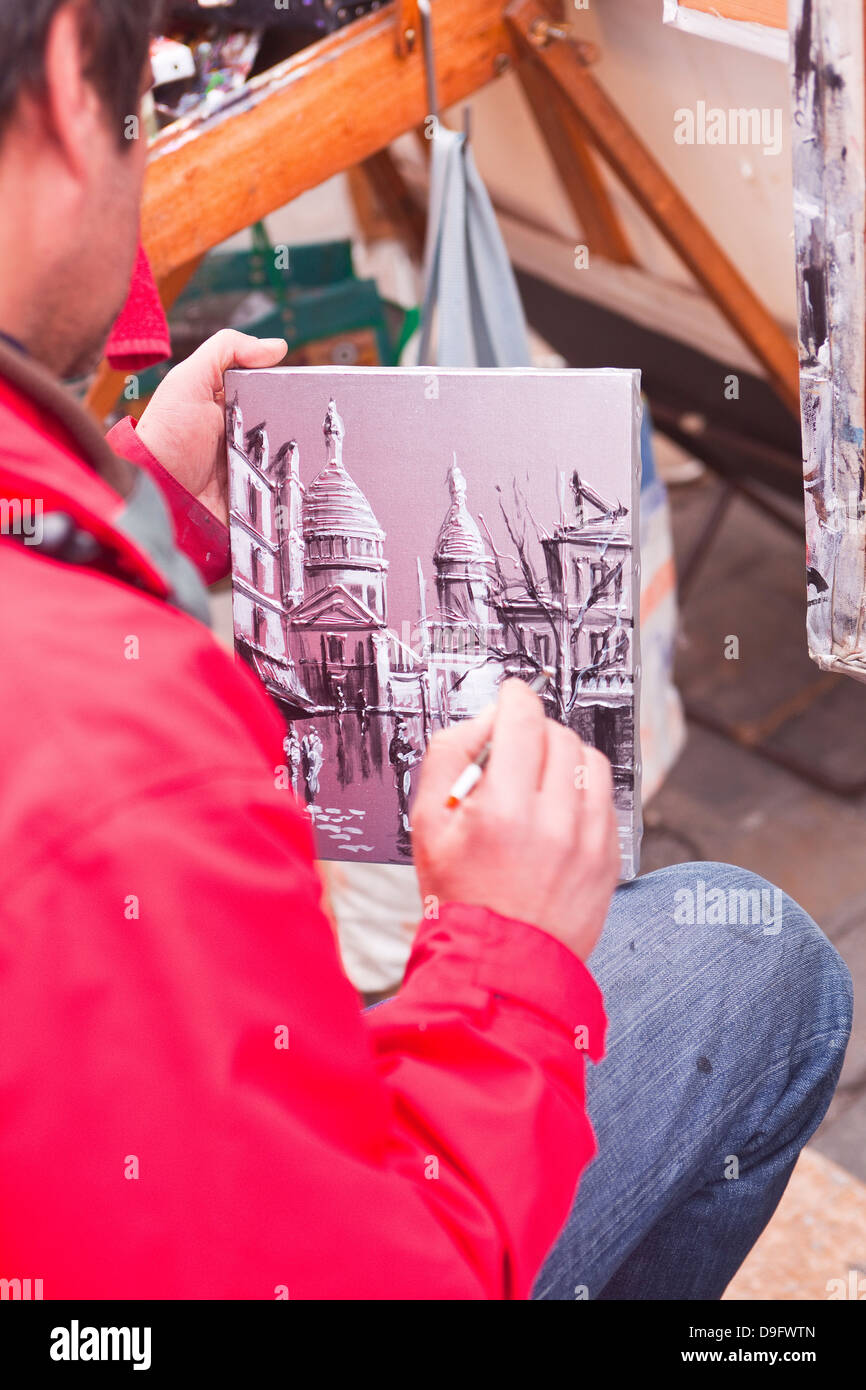 A street artist at work in the famous Place du Tertre in Montmartre, Paris, France - Stock Image