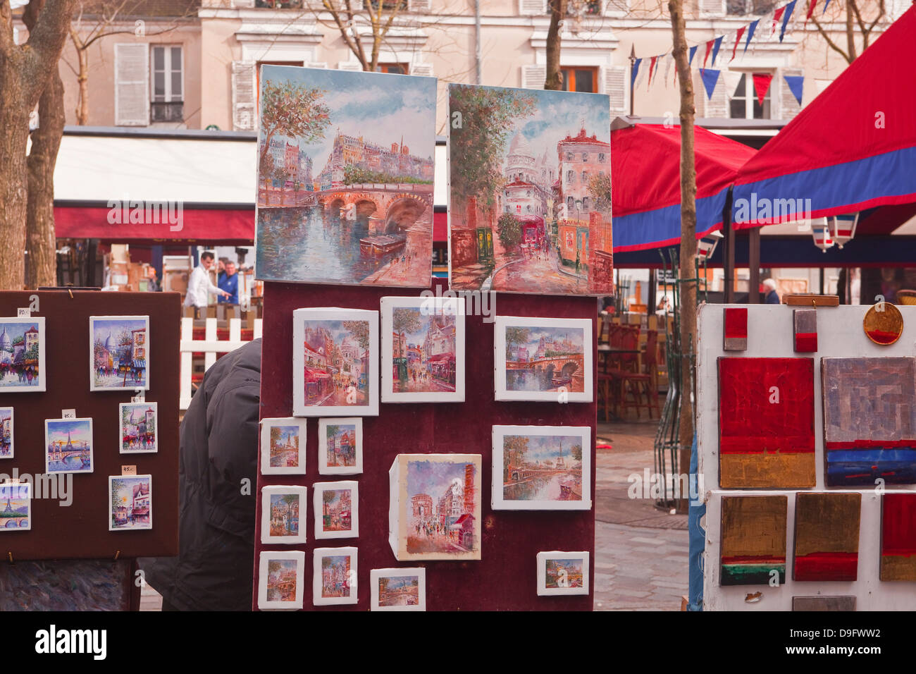 Paintings on sale at the famous Place du Tertre in Montmartre, Paris, France - Stock Image