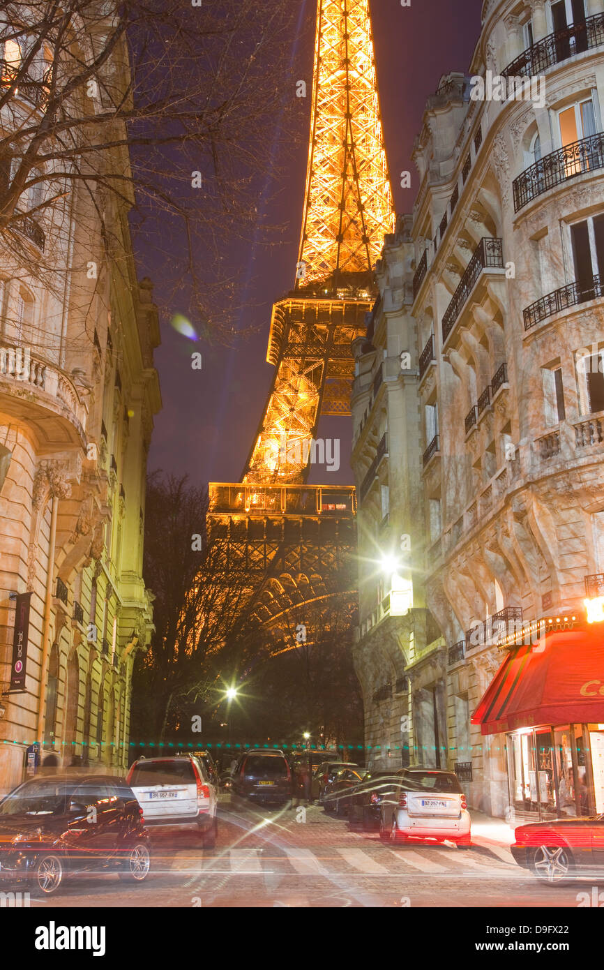 The iconic Eiffel Tower lit up at dusk in central Paris, France - Stock Image