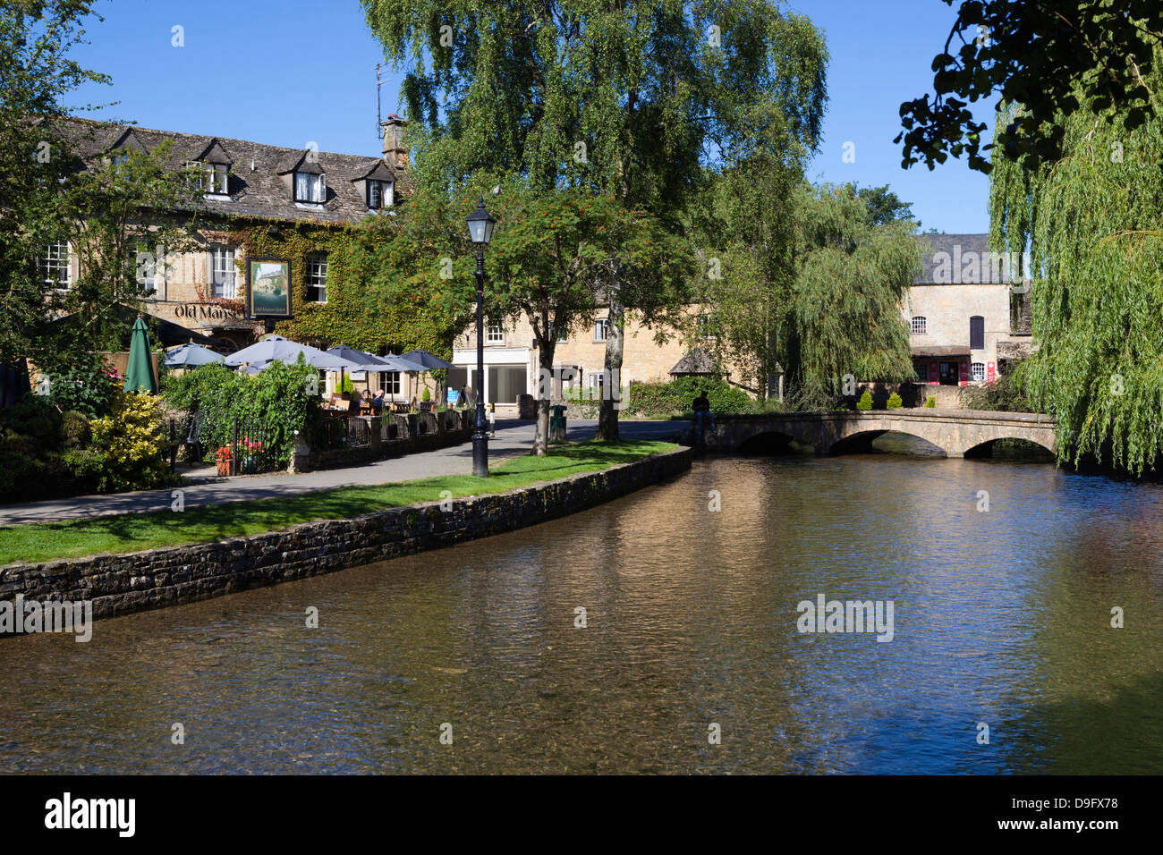 View along the River Windrush, Bourton-on-the-Water, Gloucestershire, Cotswolds, England, UK - Stock Image