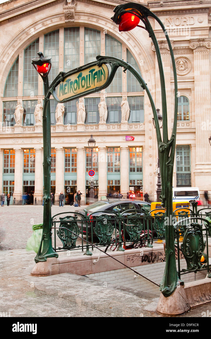 The art nouveau entrance to Gare du Nord metro station with the main railway station behind, Paris, France - Stock Image