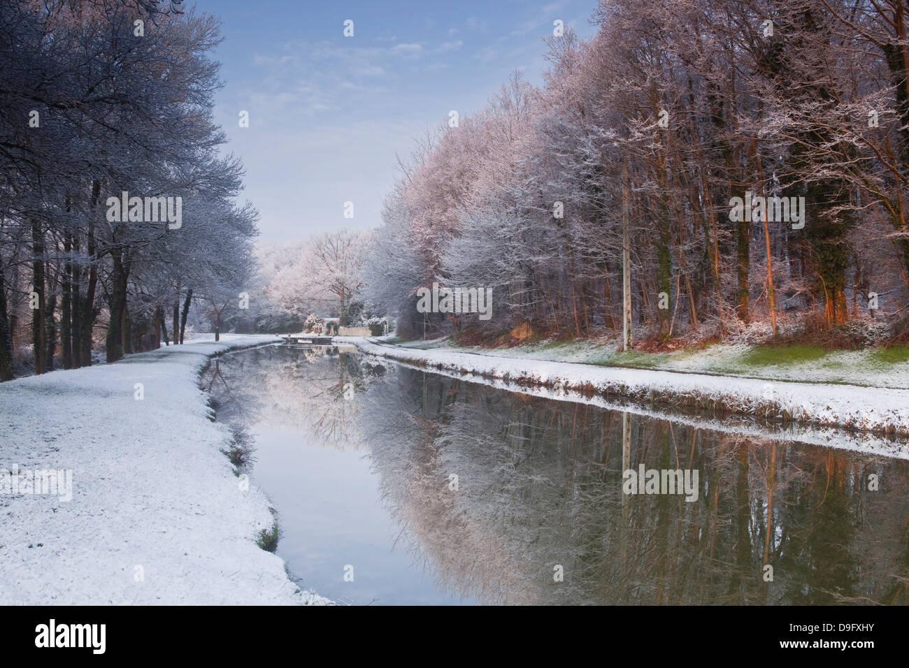 The Canal de Berry after a snow shower, Loir-et-Cher, Centre, France - Stock Image