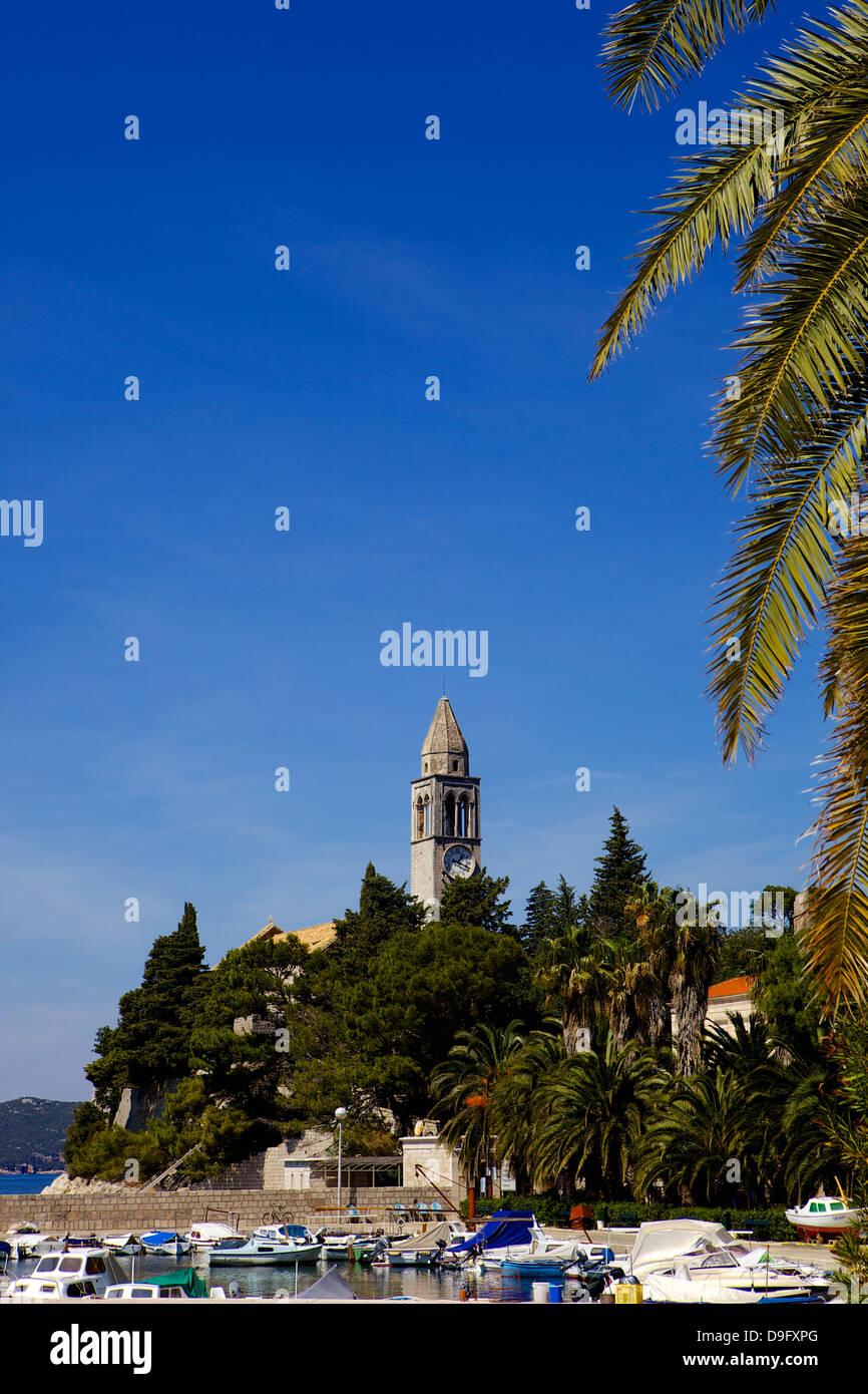 Boats in Lopud harbour and St. Mary's church, Lopud island, South Dalmatia, near Dubrovnik Croatia Stock Photo