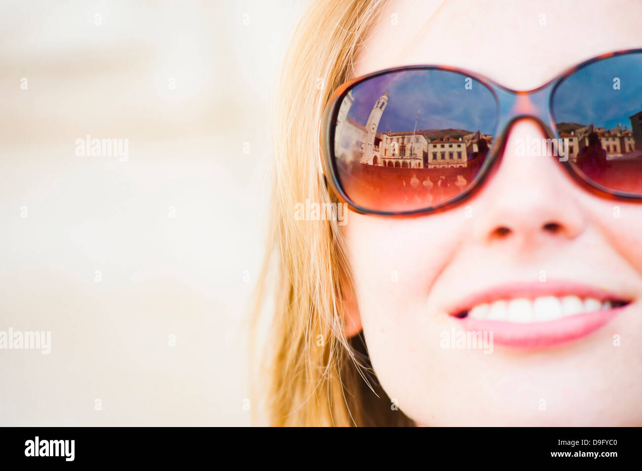 Dubrovnik City Bell Tower reflected in a tourist's sunglasses, Dubrovnik, Dalmatia, Croatia - Stock Image