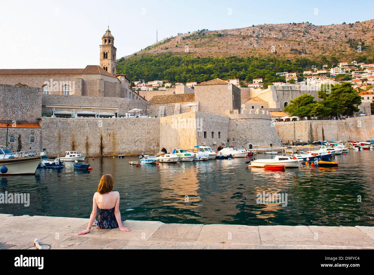 Tourist admiring Dominican Monastery, Dubrovnik Old Town, UNESCO World Heritage Site, Dubrovnik, Dalmatian Coast, - Stock Image