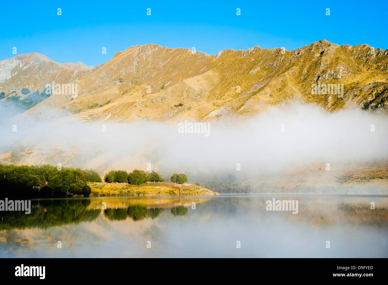Misty dawn reflections at Lake Moke, Queenstown, Otago, South Island, New Zealand - Stock Image