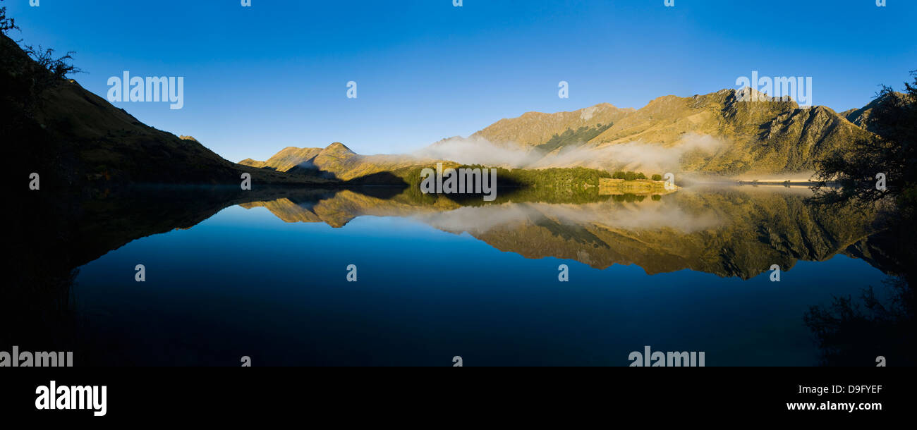 Misty reflections at dawn, Lake Moke, Queenstown, Otago, South Island, New Zealand - Stock Image