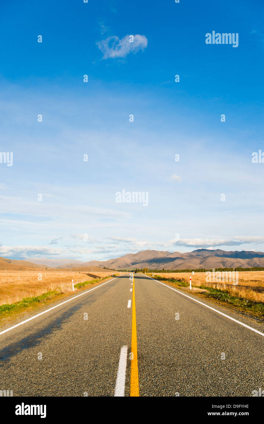 Long straight road in Otago, South Island, New Zealand - Stock Image