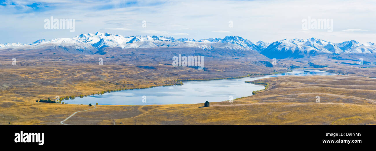 Lake Alexandrina and snow capped mountains, Canterbury Region, South Island, New Zealand - Stock Image