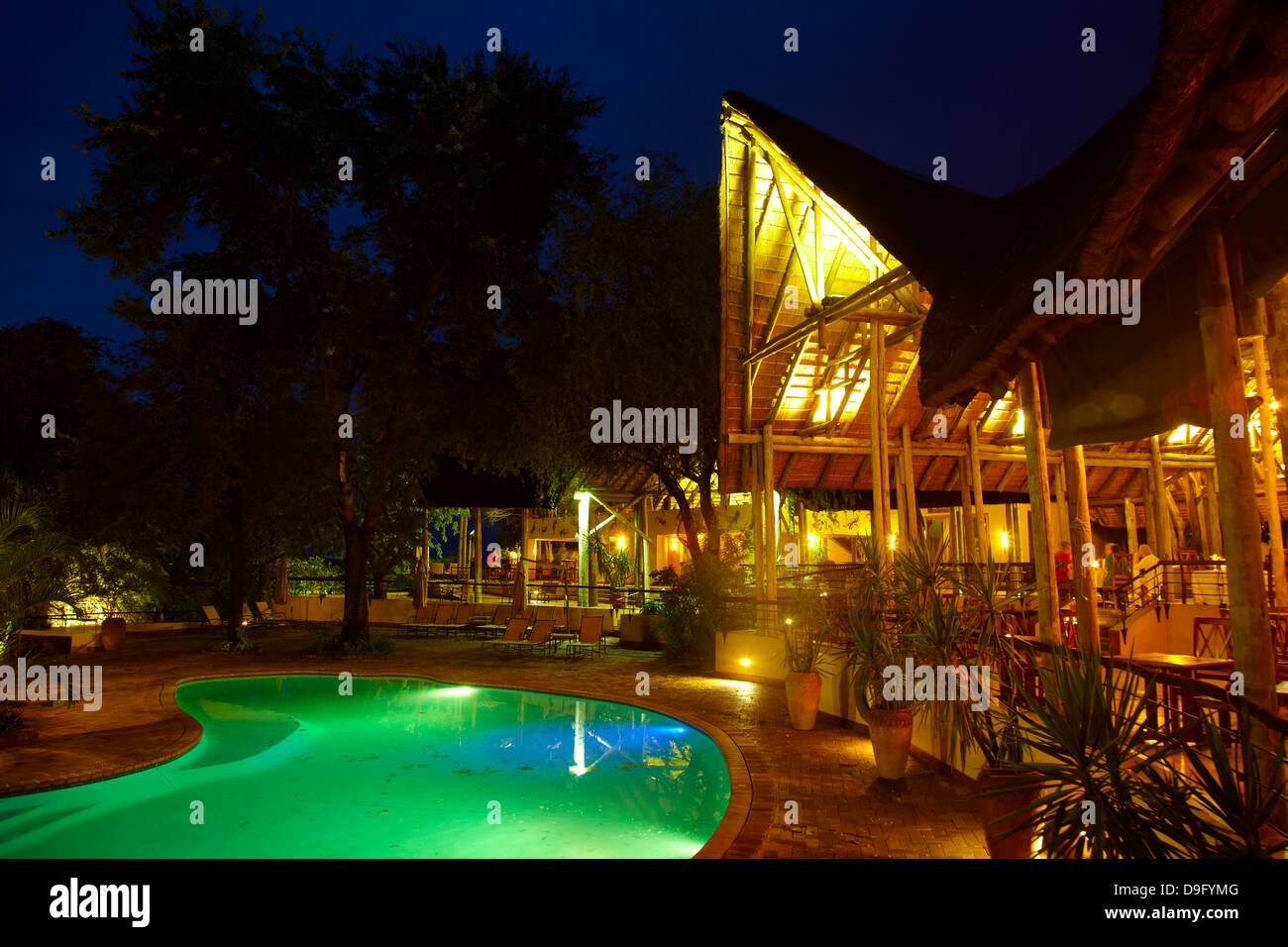 Swimming pool at dusk, Chobe Safari Lodge, Kasane, Botswana, Africa - Stock Image