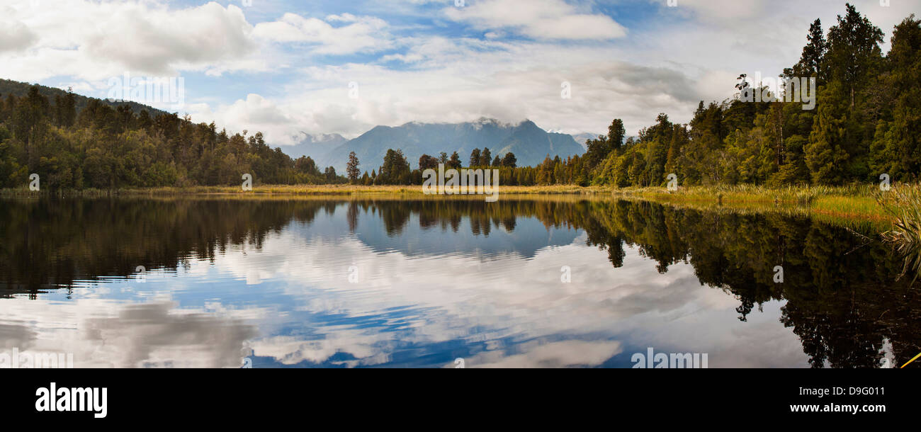 Reflections at Lake Matheson, Westland National Park, UNESCO World Heritage Site, South Island, New Zealand - Stock Image