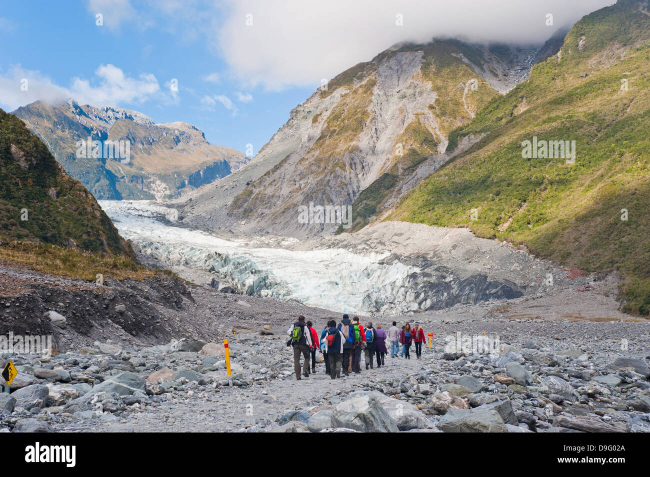 Tourists on Fox Glacier tour, Westland National Park, UNESCO World Heritage Site, South Island, New Zealand - Stock Image